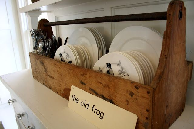 Store dishes vertically in an old tray and silverware in mason jars.  Super cute and farm housey. :)
