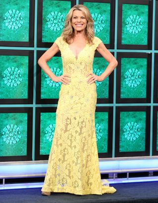 JOVANI Yellow re-embroidered lace gown enhanced in yellow aurora rhinestones, v-neckline, cap sleeves, keyhole cutout back, flared hemline w/train | Vanna White's dresses | Wheel of Fortune