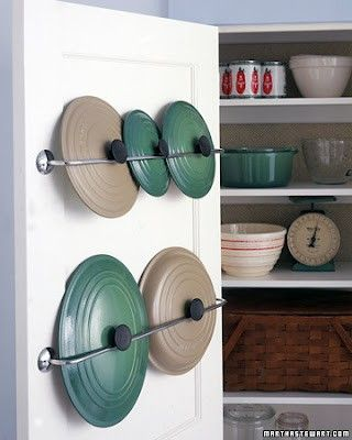 ****Kitching Storage****  Keep your pot and pan lids from rolling around your cabinet by sliding them into a towel rack mounted on the inside of the door.