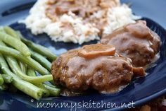 Salisbury Steak    2 - pounds ground beef  1 - package Lipton's French Onion Soup Mix or Store Brand  1/2 - cup cracker crumbs  1 - egg  2 - packets (0.75 oz) brown gravy mix  + the required amount of water stated on the gravy packet.  1 - cup sour cream  1 - small can mushroom stems, optional  egg noodles, rice or mashed potatoes