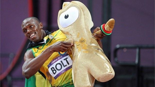 Usain Bolt of Jamaica celebrates winning gold with Wenlock