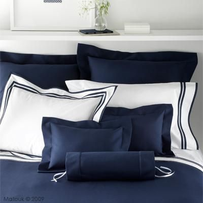 Navy blue bedding by Matouk is a must!