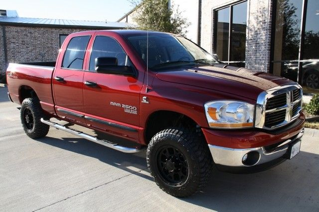 Red Lifted Dodge ram 2500 truck