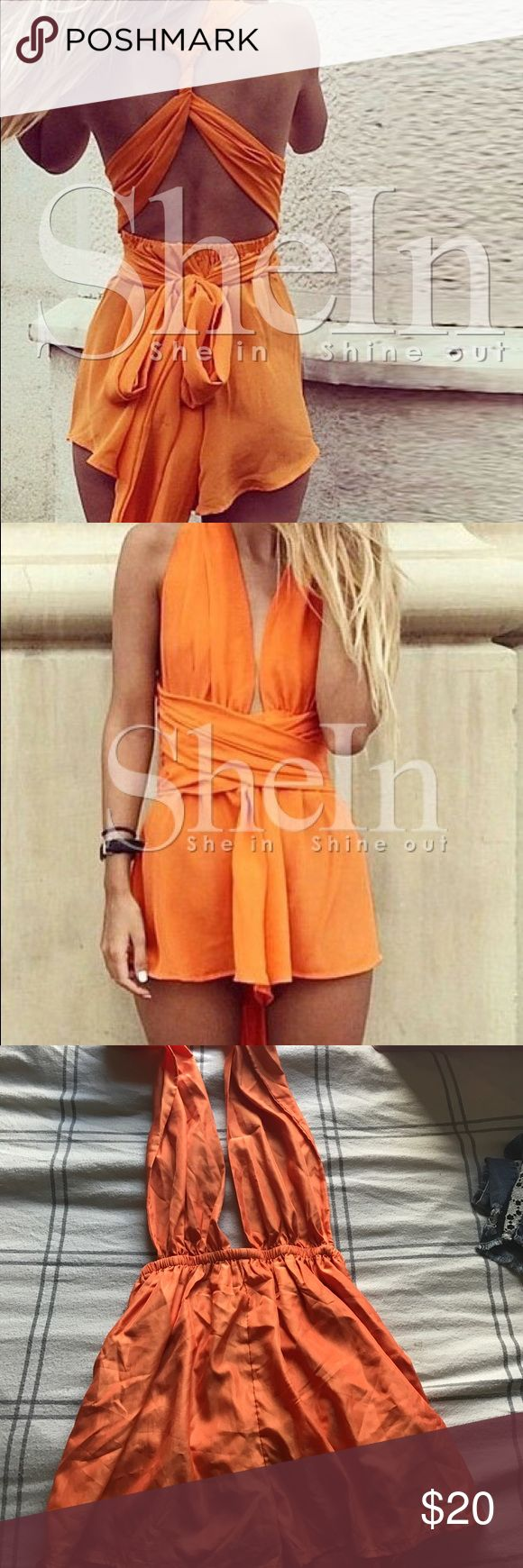 Rare Orange sleeveless backless playsuit Sold out online, orange, sleeveless, backless play suit. Super cute, never worn, brand new! ROMWE Pants Jumpsuits & Rompers