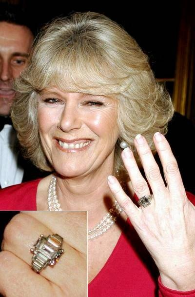 Mrs Parker Bowles' engagement ring is a Windsor family heirloom that belonged to Queen Elizabeth, The Queen Mother. With a 1920s platinum setting, it is composed of a square-cut central diamond flanked by six diamond baguettes.
