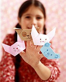 Paper napkins are used to create a menagerie of origami animals: bunnies, a dog, and a bear that can be made during the party.