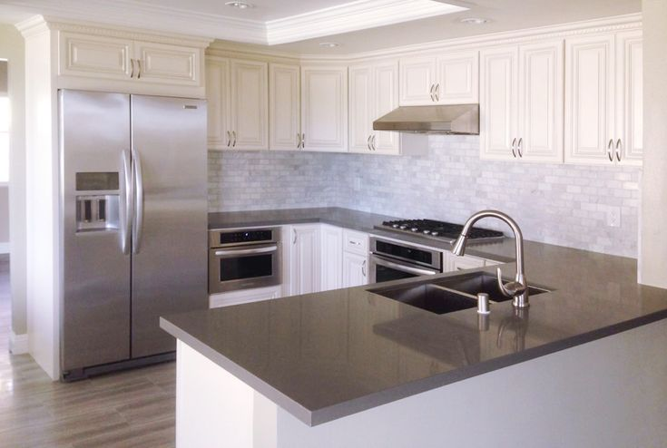 Antique White Kitchen Cabinet With Grey Quartz Countertop