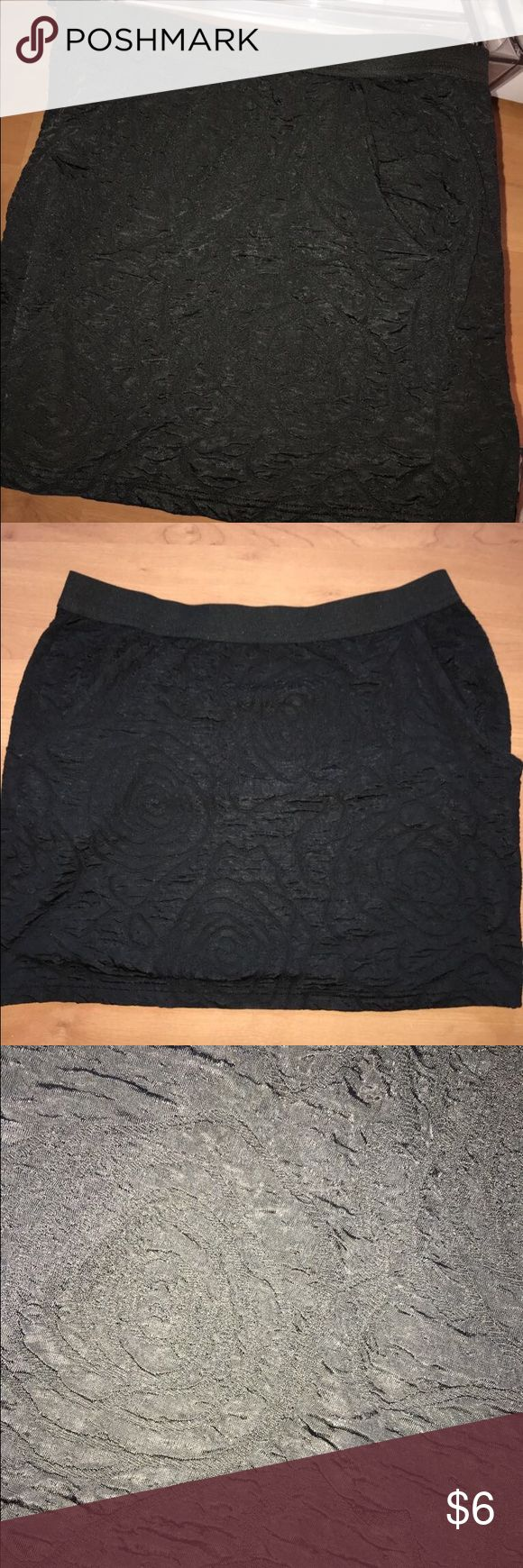 Little black skirt Pre loved. Cute tulip skirt with pockets on the sides. Has been worn Urban Outfitters Skirts Mini