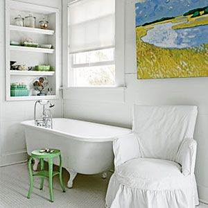 """White, Watercolor Bath """"Minimizing distractions in your decor puts a spotlight on the key elements. In this case, the focus goes straight to the classic claw-foot tub and vibrant painting."""" CoastalLiving.com Pinner's Note: Remember it is usually not recommended to use artwork of value in a bathroom due to moisture in the room!"""