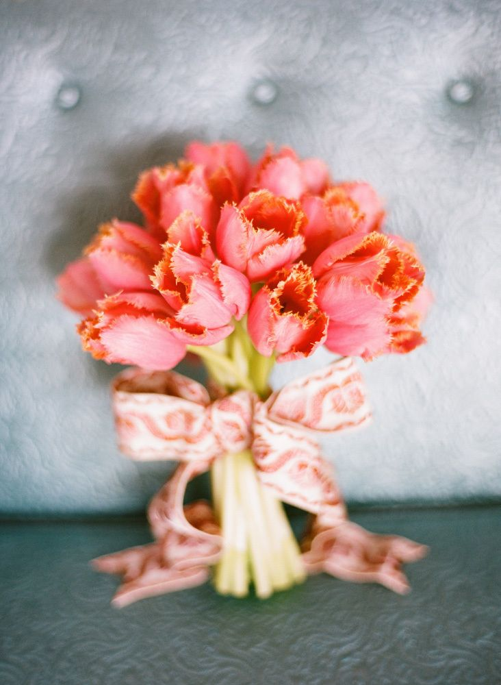 A bouquet of coral tulips! {Photo by Ryan Ray via Project Wedding}