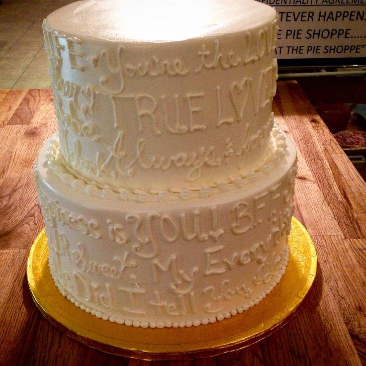 "Sweet ""love"" sayings written on this wedding rehearsal dinner cake."