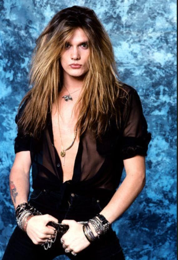 Sebastian Bach; I totally dig the whole hair band look from the 80's.. its so strangee.. lol