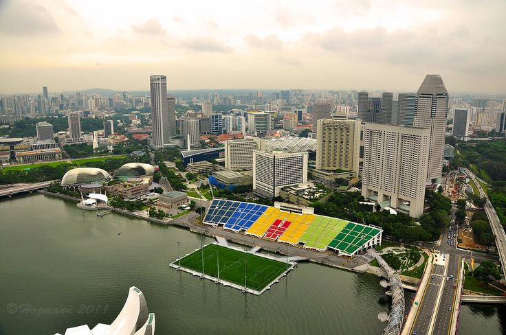 Marina Bay Floating Stadium - Singapore  The floating bay platform can withstand 1070 tonnes and plays host to football matches and music concerts as well as the stand being used for Formula 1 races.