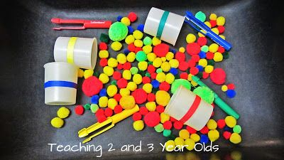 Teaching 2 and 3 Year Olds: Teachers   Pom Poms, Cups and Tweezers // Pom poms are soft and easy to move with the tweezers. We added colored masking tape to each cup as another way to sort the pom poms.