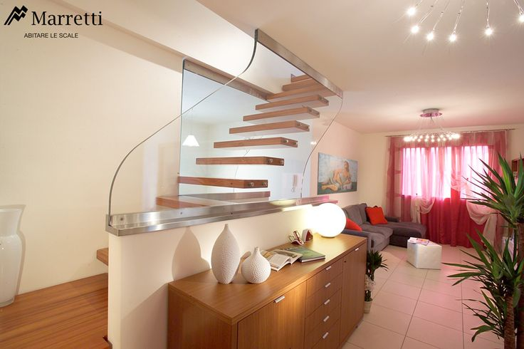 Open cantilever staircase with ultra-clear structural glass banister and steps in doussié wood