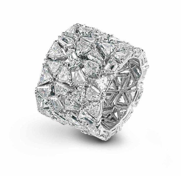 Chopard cigar band of trillion cut diamonds...
