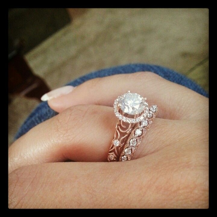 Rose gold engagement ring.. not usually a fan of this layout but this is gorgeous!