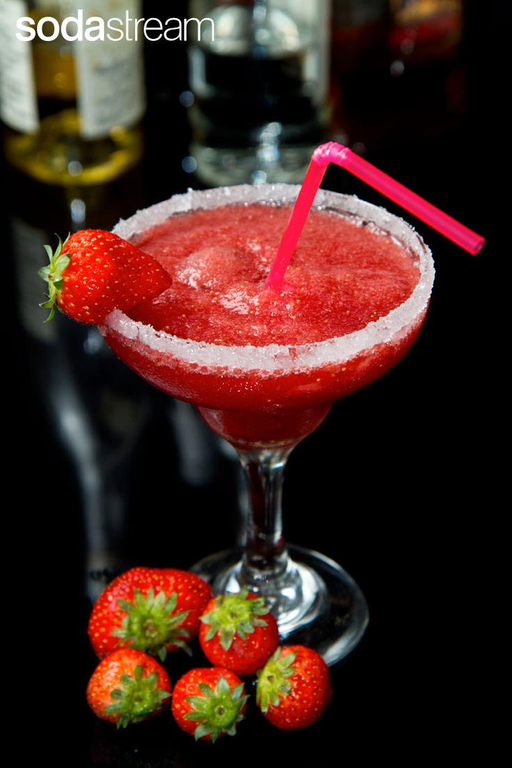 For todays brunch let's mix a virgin strawberry margarita! Wet the rim of a tall glass with a lime wedge and dip it in raw sugar. Now fill the glass with ice and pour over it the new SodaStream Margarita Soda. Garnish with a strawberry and a lime wedge.