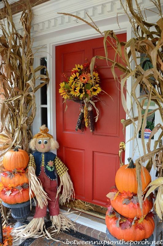 autumn porch decorated with pumpkin topiaries between naps on the porch - Fall Halloween Decorations
