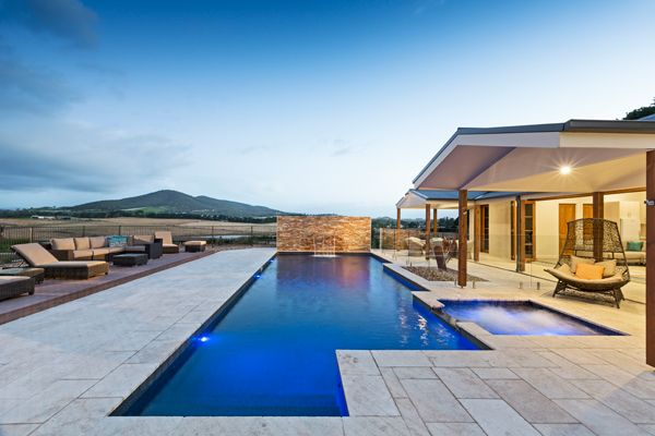 2015 SPASA VIC Award Winning Pool Project. Geometric lap pool design complete with a spa off to the side. 12.0m in length and 5.0m in width featuring a black pool interior and black spa tiles creates a striking contrast with the travertine surrounding tiles.