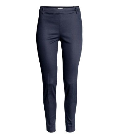 Dark blue. Ankle-length cigarette trousers in a stretch weave with a regular waist, concealed zip in one side, fake pocket at the back and slim legs with