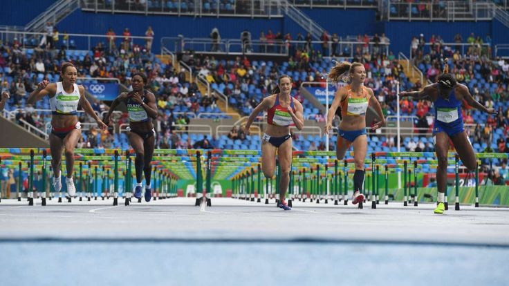 Track and field at the Rio Olympics  -    Competitiors finish their 100-meter hurdles heat of the women's heptathlon at Estadio Olimpico Joao Havelange during the 2016 Rio Summer Olympic Games.