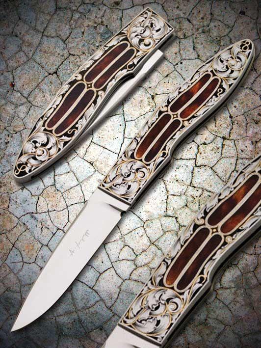 Knifemaker Antonio Fogarizzu  Folder  Blade: RWL 34  Handle: 416 ss  Inlays: Ancient Tortoise  Lock Back  Total Length: cm 18  Engraver: Pedretti