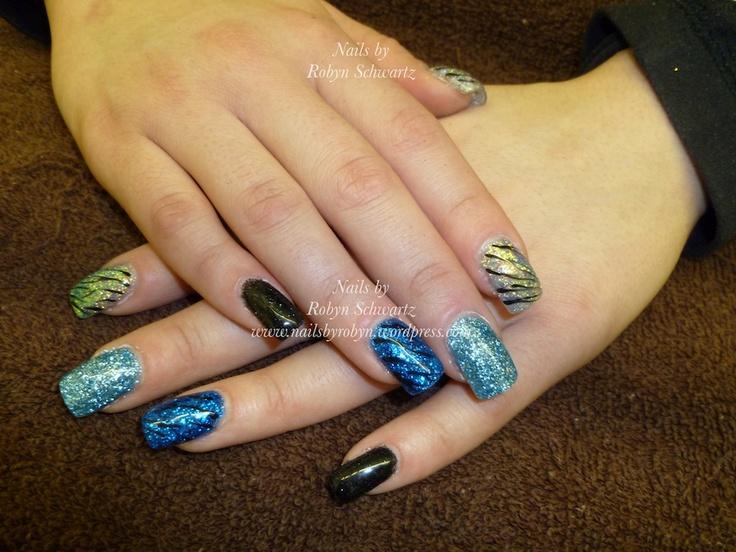 Love me some zebra!  Gel nails, glitter and hand painted zebra stripes.  Fabulous!