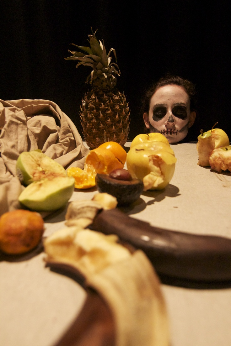 a Still Li[v]e (live performance modeled after traditional still lives) I did for a class.  Rotten fruit and a live skull.