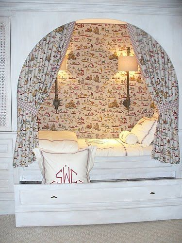 Love the fabric covered walls in this sleeping nook. Pull out trundle is a great idea too.