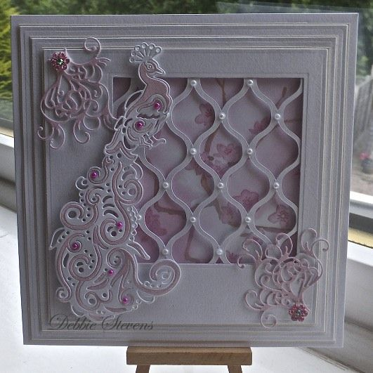 Debbie Stevens  using the tattered lace peacock die.  I am wanting tattered lace dies so badly!