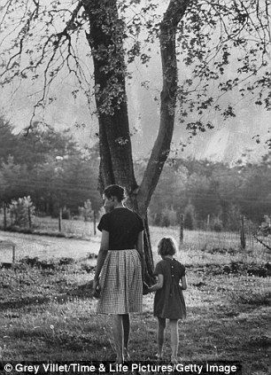 Mildred Loving and her daughter walk hand-in-hand near their home in Central Point, Caroline County, Virginia, May 1965.
