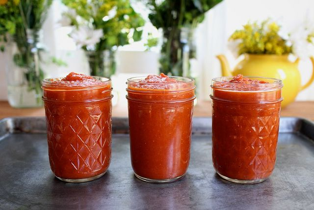 Homemade Spicy Ketchup Recipe Condiments and Sauces with olive oil, onion, garlic, tomato paste, salt, ground mustard, paprika, ground cloves, ground allspice, crushed red pepper flakes, tomatoes with juice, brown sugar, apple cider vinegar