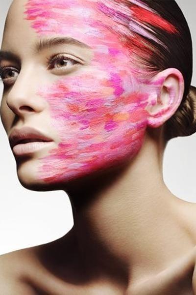 beauty shot of model Vanessa Hegelmaier strong pink makeup look.