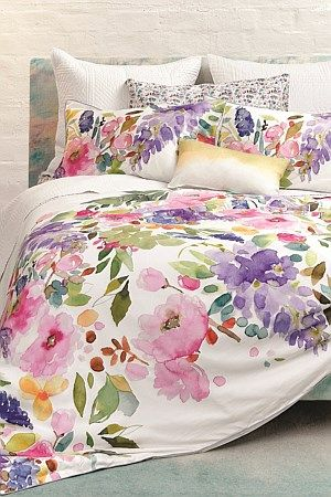 The Wisteria duvet features Fi's signature, watercolour florals with delicate purple, pink blooms and soft greens in pretty, painterly brushstrokes in this feel good design.