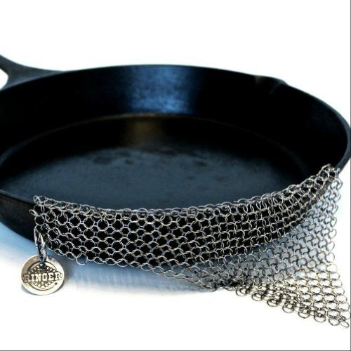 The Ringer® chainmail scrubber for cast iron. Pricey but worth it. $35 (often on sale $18-$24)