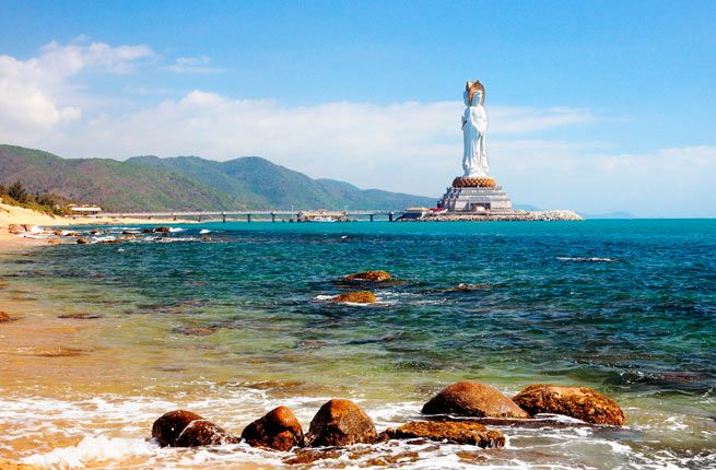 Hainan Island, China : tropical island off China's southern coast is home to gorgeous beaches, a volcano park, monkeys, a Shaolin Buddhist temple, an ancient Hainanese village : Where to Stay: The Ritz Carlton, Sanya offers luxury in the island's main hub. If you want an escape, head to Le Méridien Shimei Bay Beach Resort & Spa, located on a bay where you'll find Hainan's best surf.