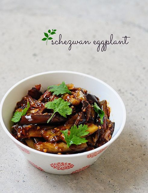 "Chinese style eggplant-szechuan eggplant  1 eggplant cut into 1"" wide wedges 5-6 shallots or pearl onions 1 tsp of minced garlic 1 tsp of red red chilli sauce (Sriracha, Maggi, anything works) or chilli flakes 2 tbsp of soya sauce 1 tsp of regular white vinegar 1 tsp of cornflour or corn starch 1/2 tsp of brown sugar (or jaggery) 1 small bunch of coriander leaves / cilantro 1/2 tsp of black pepper powder 2 tbsp of sesame oil (Indian gingelly oil) or peanut oil 1 cup water"