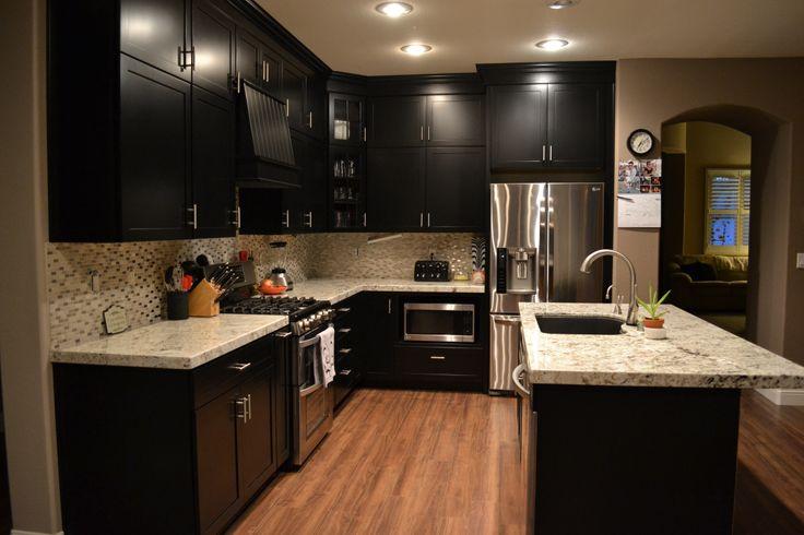Kitchen at 90 complete kraftmaid cabinetry black for Black onyx kitchen cabinets