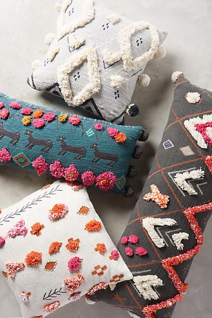Anthropologie Heradia Pillow.  Pom Poms for your home.  Add a dash of color with pillows to jazz up any room decor!