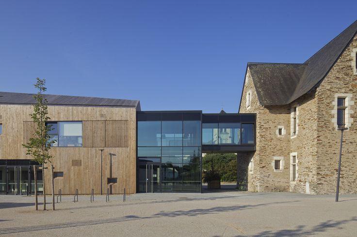 Prix national de la construction bois - Panorama - Immeuble d'habitation dans le centre bourg d'Ecouflant