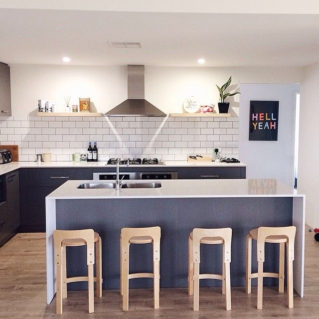 Kitchen style by YellowDandy on Instagram. Essa stone benchtops and laminex cabinets. Hudson stools from Mocka and white #subwaytile with dark grout #kitchen #yellowdandy