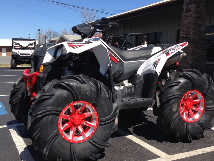 Polaris Scrambler 1000 White Lightning 32 1/2 outlaw tires and no limit wheels 5in outcast lift