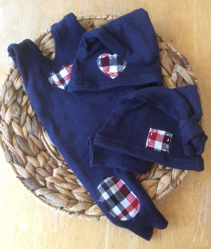 A personal favorite from my Etsy shop https://www.etsy.com/ca/listing/553856945/newborn-baby-upcycled-navy-knit-romper-2