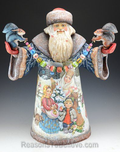 """Welcoming Christmas - Large, hand carved, solid wood Santa Claus holding two squirrels and string of colorful wooden ornaments. 20"""" tall x 15"""" wide x 9"""" deep."""