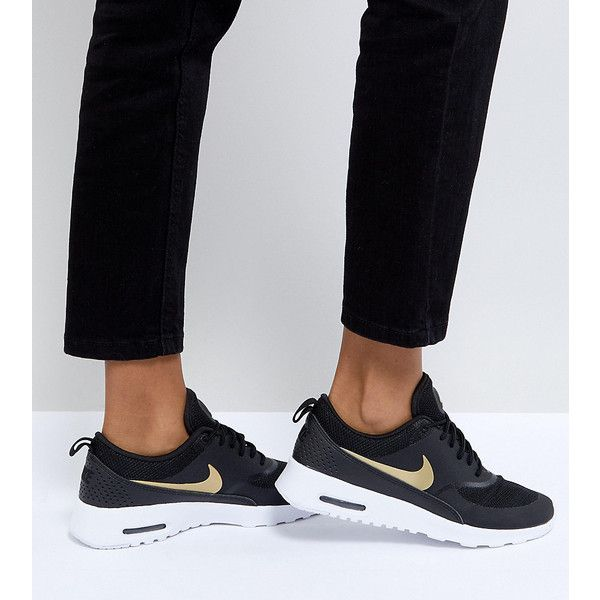 Nike Air Max Thea Trainers In Black And Gold (€125) ❤ liked on Polyvore featuring shoes, sneakers, black, black hi tops, high-top sneakers, black sneakers, black laced shoes and black gold sneakers