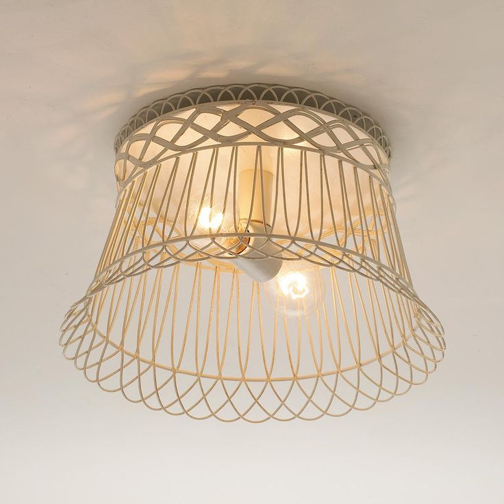 Vintage Style Wire Basket used as a Ceiling Light.
