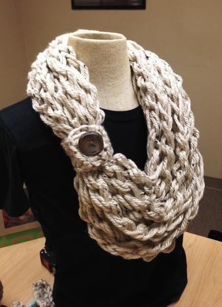 Kay's crochet rope scarf is made with 2 strands of bulky weight yarn and finished with a woodbutton. These scarves are made in one long crocheted rope. You can