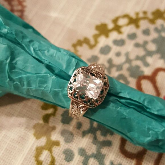 Costume Diamond Candle ring Costume ring from Diamond candles. Size 7 with super cute filigree around the stone. Diamond Candles Jewelry Rings