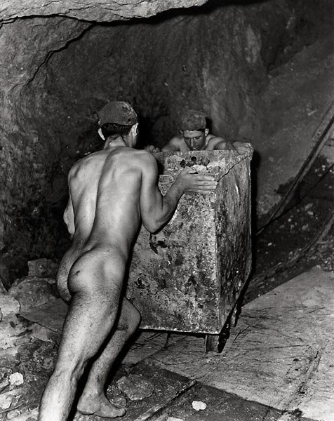Fulvio Roiter - Miners working in a sulphur mine in Caltanissetta, Sicily. Forced to work naked in the sweltering heat as the clothes stuck to their skin. Solfatara, Sicily, 1953